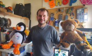 Nick Hardman with two of his custom-made teddy bears